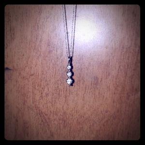 White gold diamond past, present, future necklace